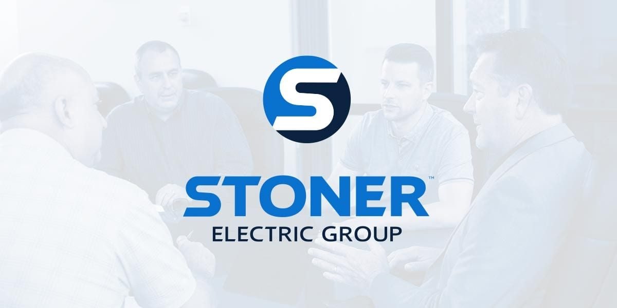 Shows four of the Stoner Electric team with the logo overlaid